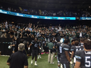 Tulane players celebrating with the student section